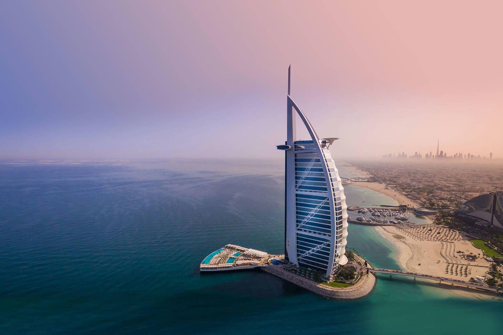 view of the sail shaped Burj Al Arab hotel on the dubai coastline