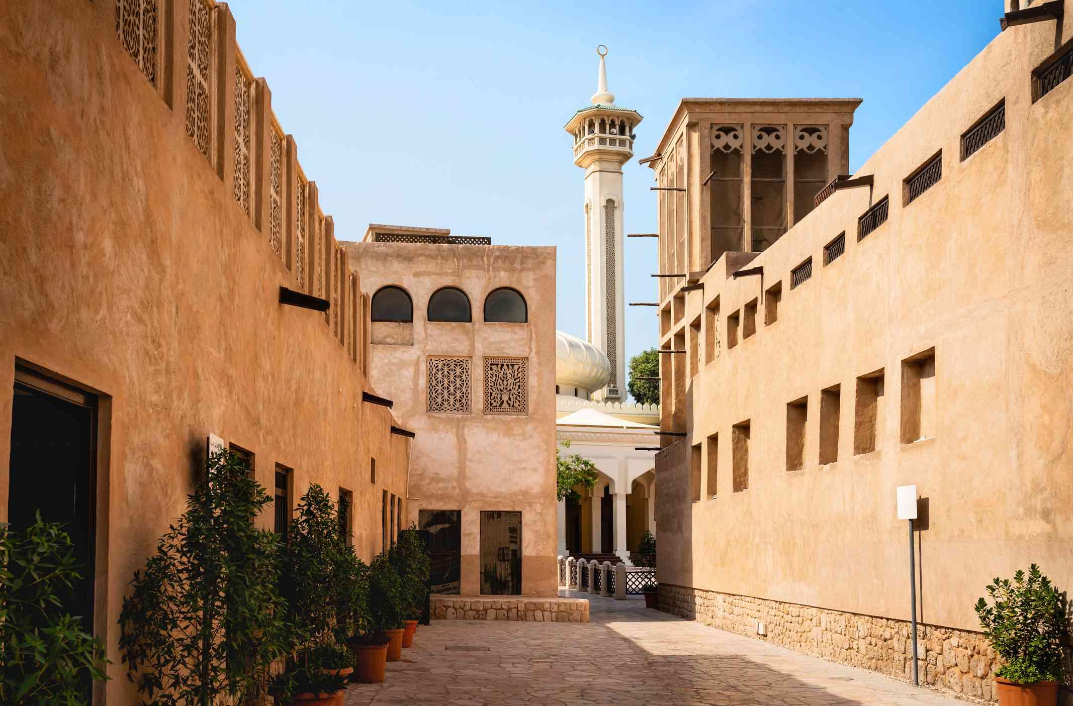 Old Dubai view with mosque, buildings and traditional Arabian street. Historical Al Fahidi neighbourhood, Al Bastakiya. Heritage district in United Arab Emirates.