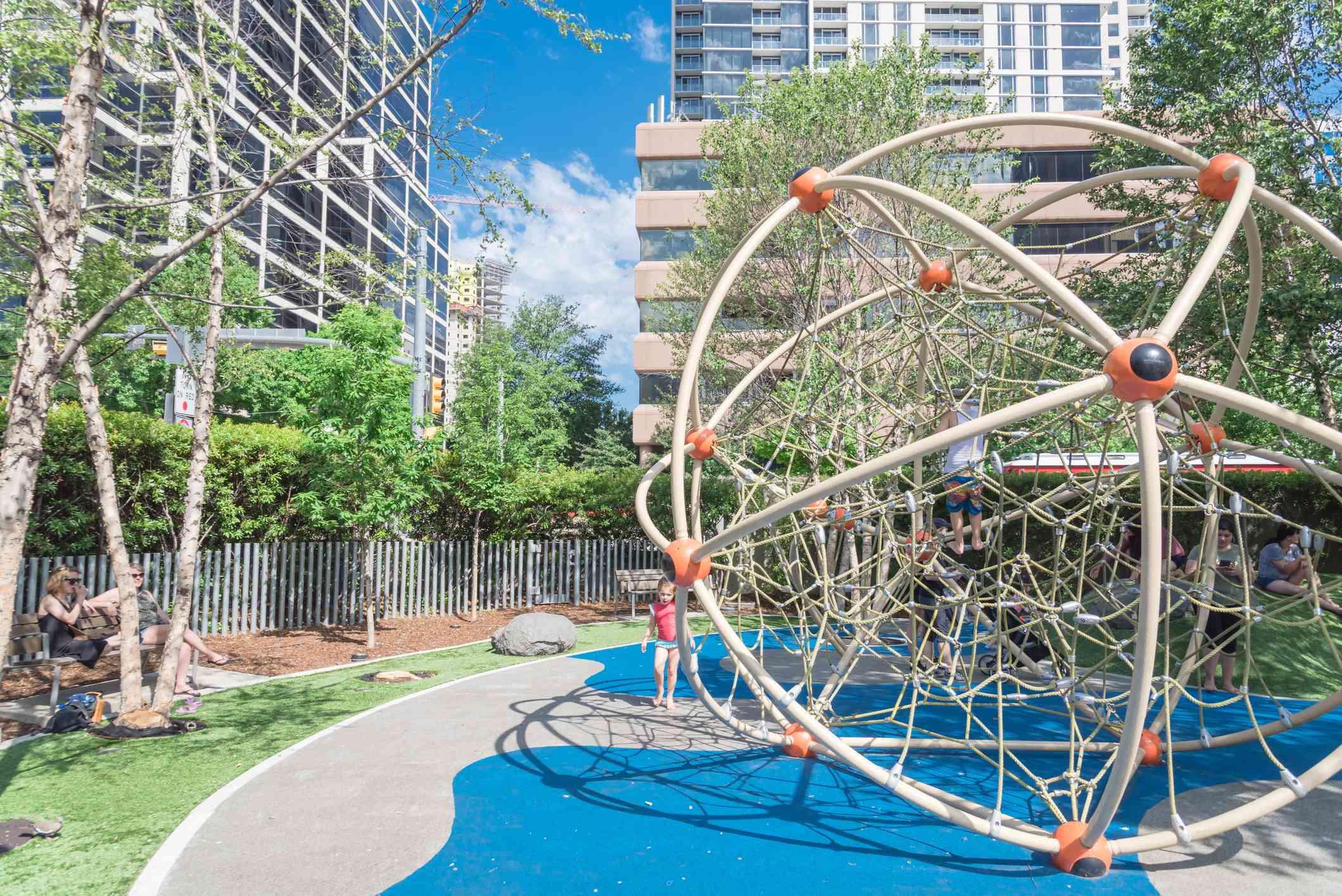 A large kid climbing structure at children area playground in Klyde Warren Park