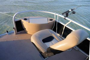 The Brocraft Pontoon Boat Rod Holder mounted on a boat