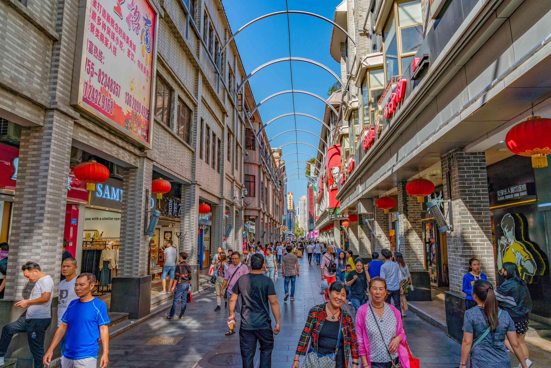 Shoppers along Donmen Pedestrian Street in Shenzhen, China
