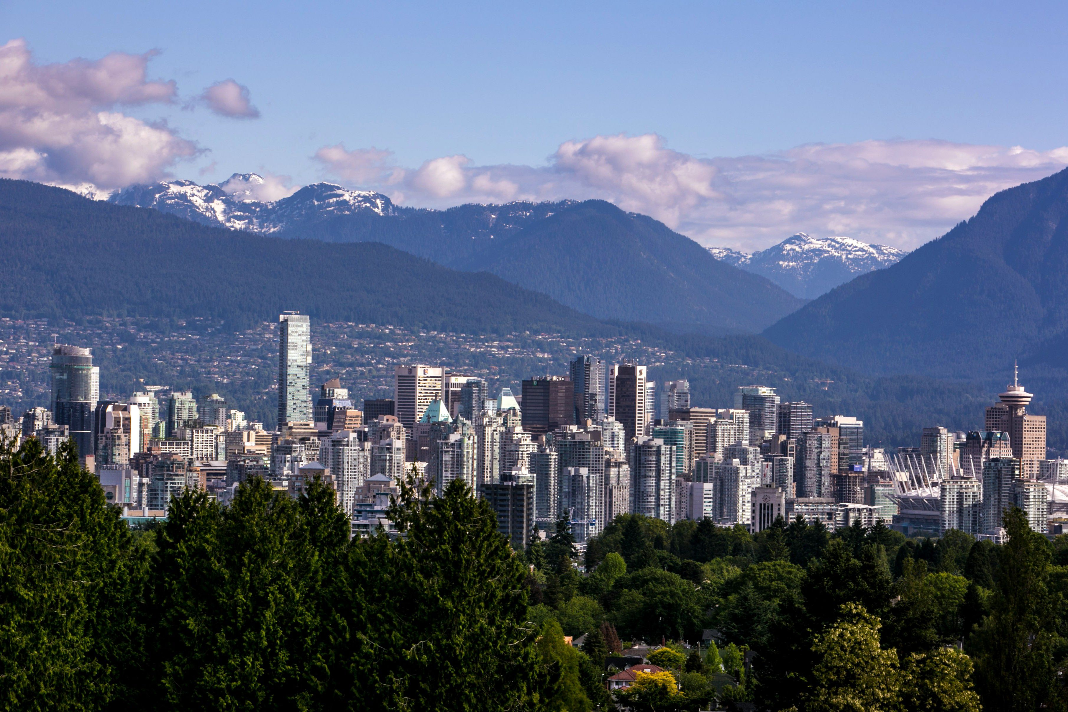 Vancouver city skyline, with Stanley Park in foreground and Coastal Mountains behind