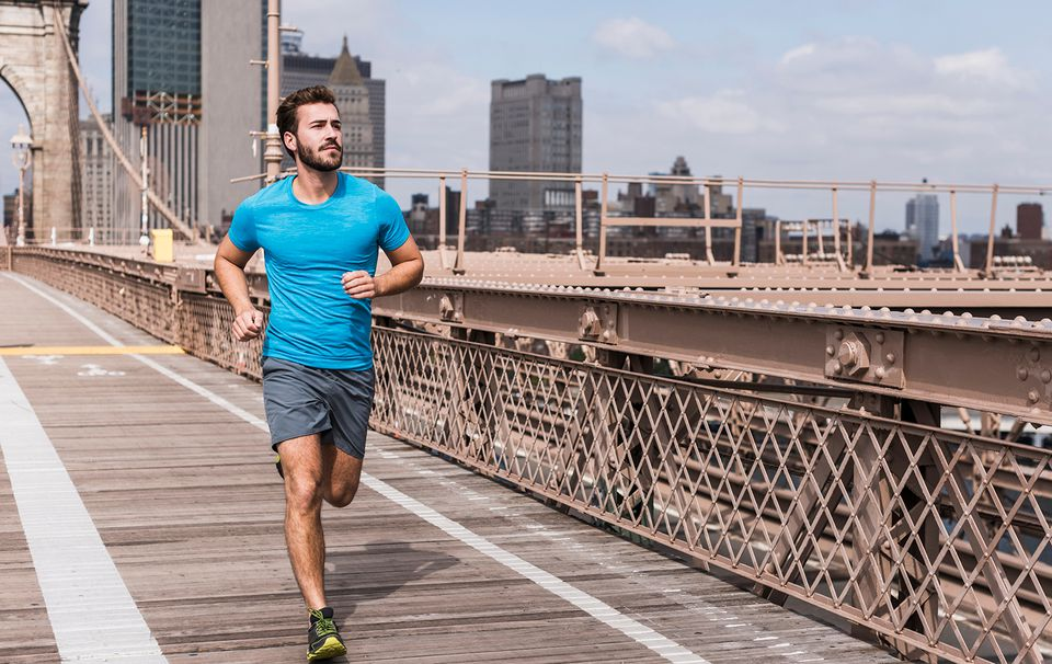 Man running across Brooklyn Bridge
