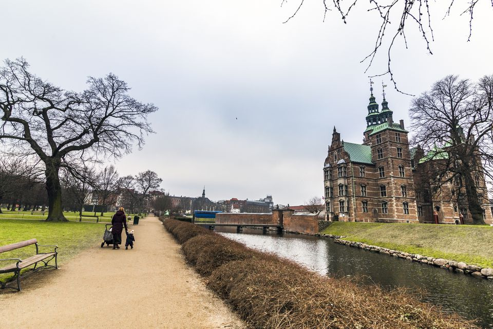 Woman with a child walking near Rosenborg Castle , Copenhagen