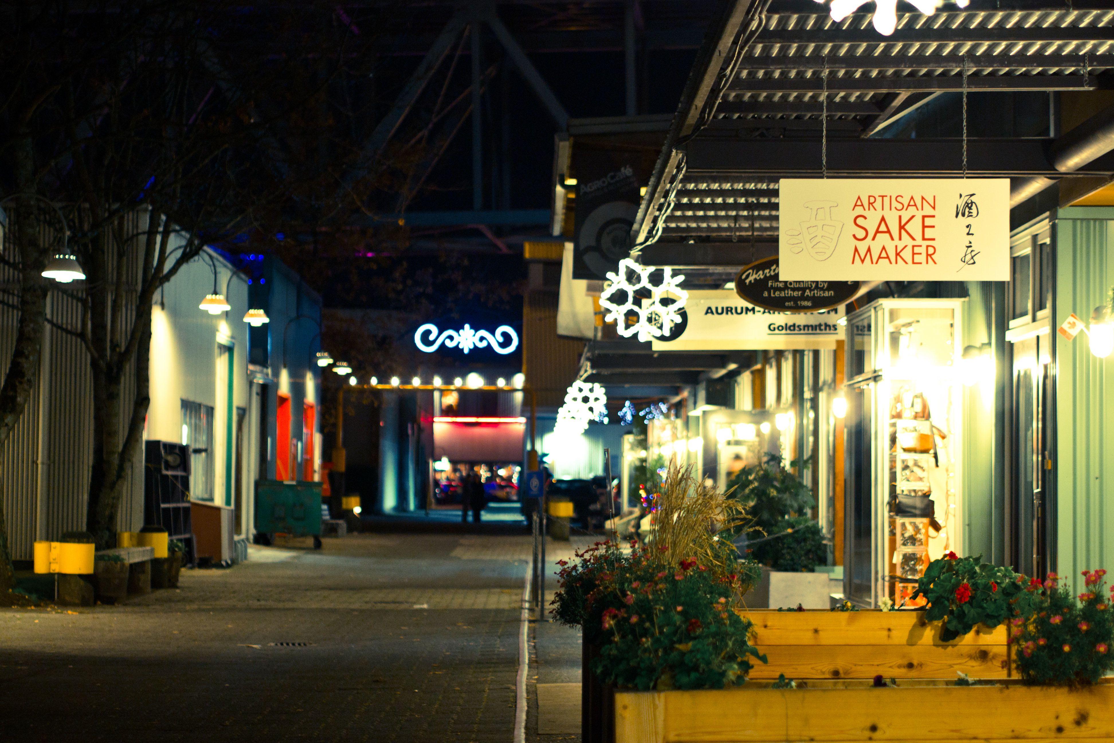 View of the Artisan Sake Maker shop at night