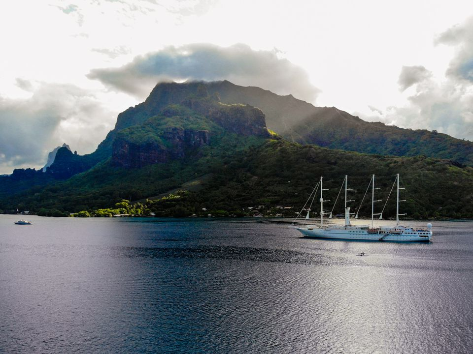 A sail boat cruising up to Moorea