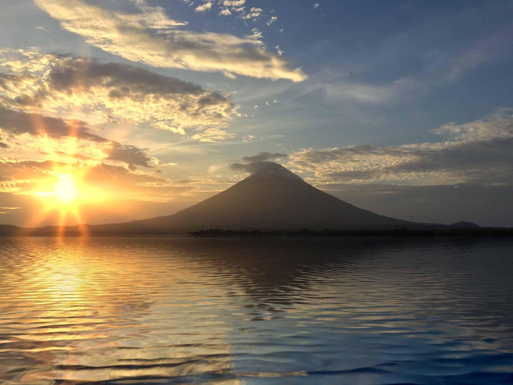 Silhouette Volcano Against Sunset Sky In Ometepe Island