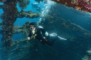 Scuba diver at wreck of USAT Liberty, Tulamben, Bali, Indonesia