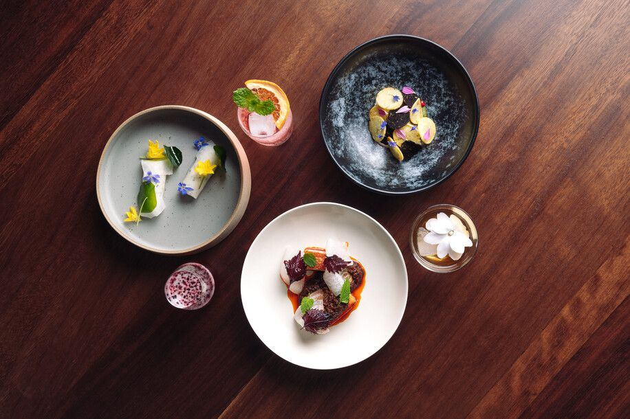 Overhead shot of three small plates and three drinks from Sid at the French Café