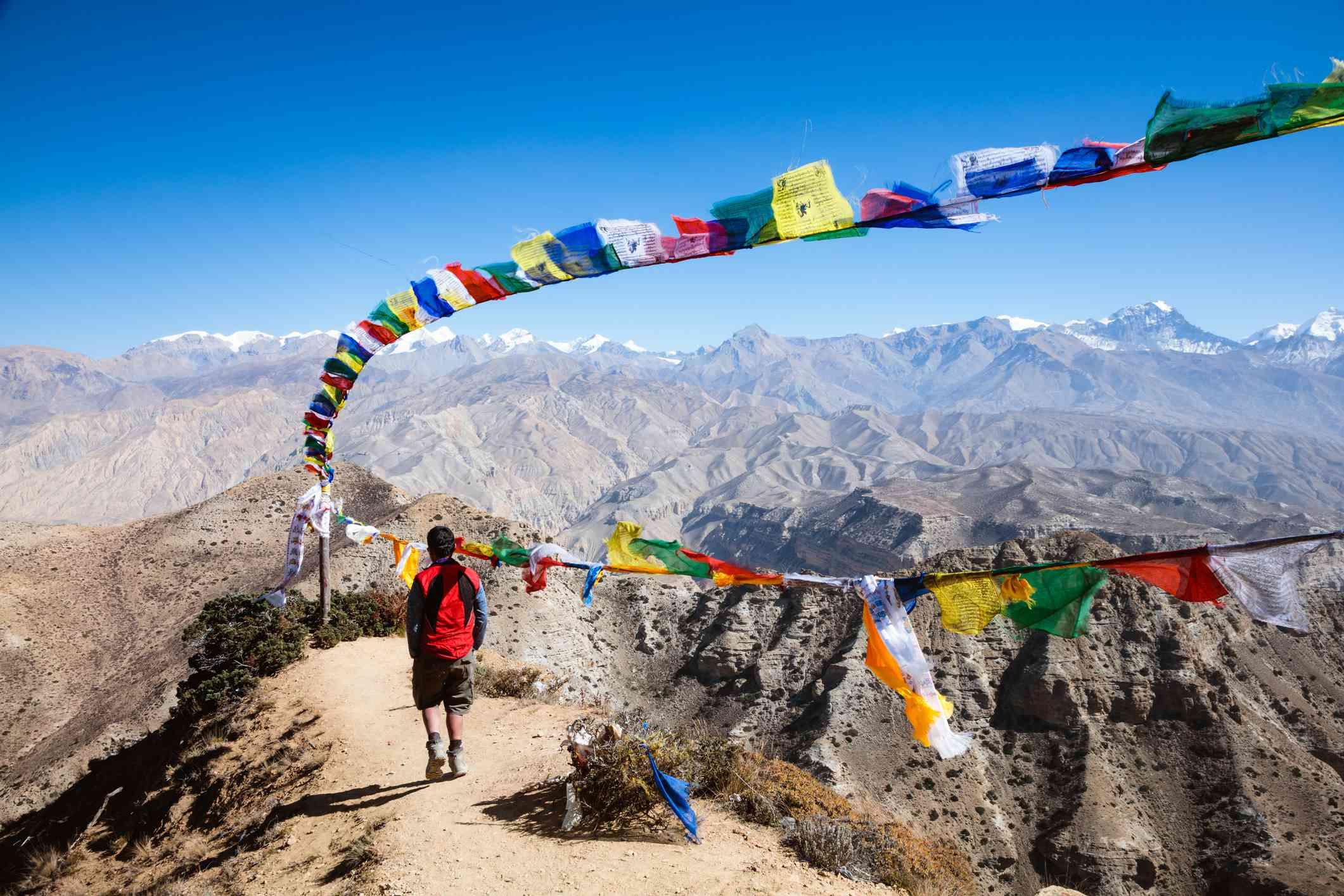 Hiker relaxing on mountain high pass, Upper Mustang, Nepal
