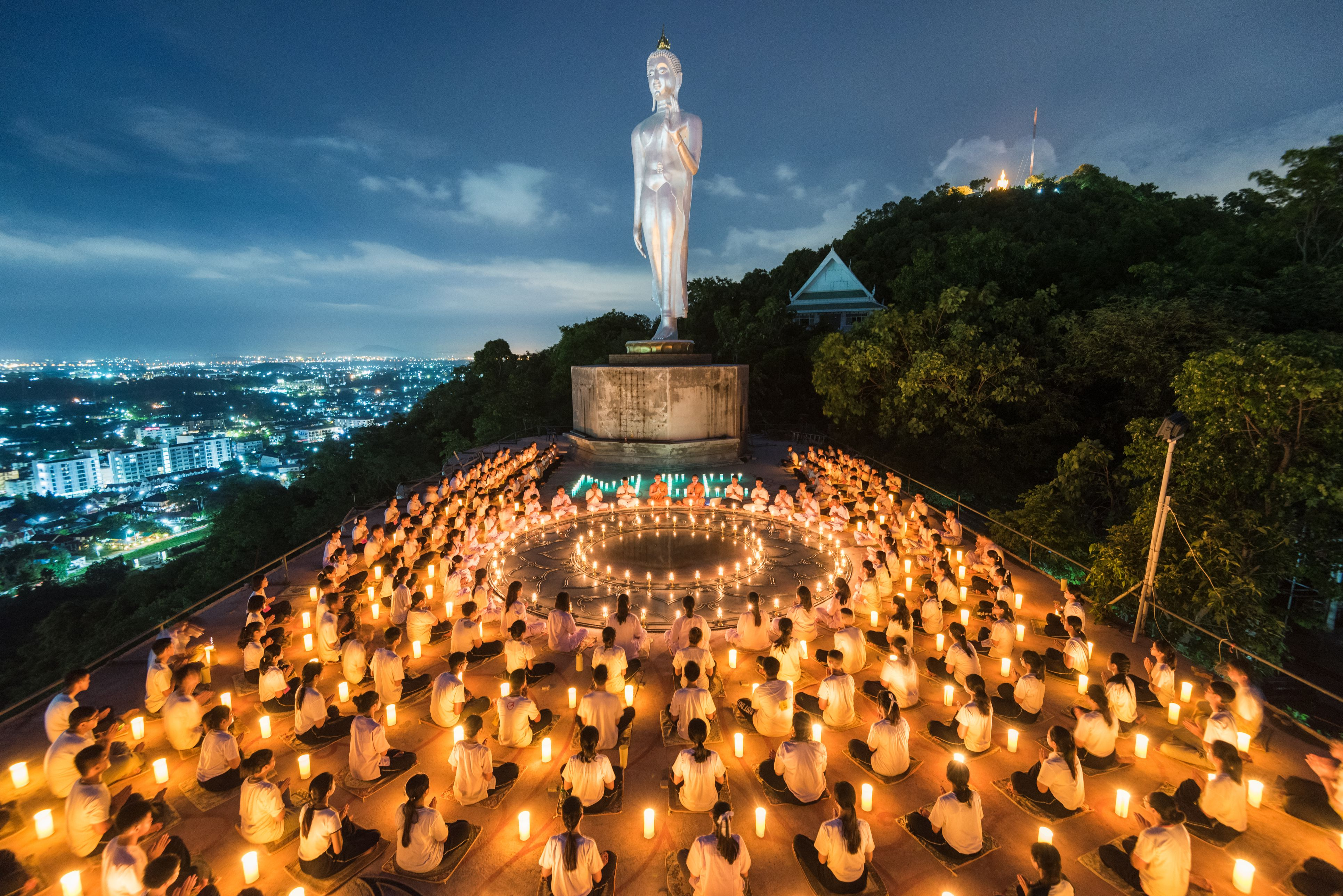 Young buddhist novices with light from candle