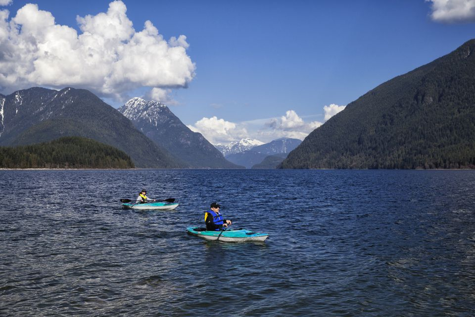 Couple kayaking at Alouette Lake, BC, Canada