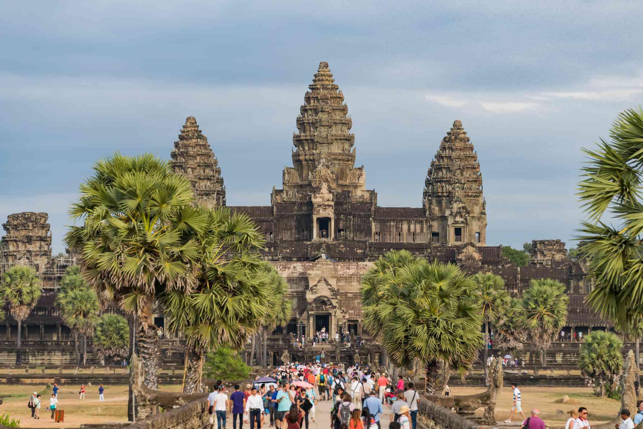 Tourists visit Angkor Wat temple at sunset, Siem Reap, Cambodia