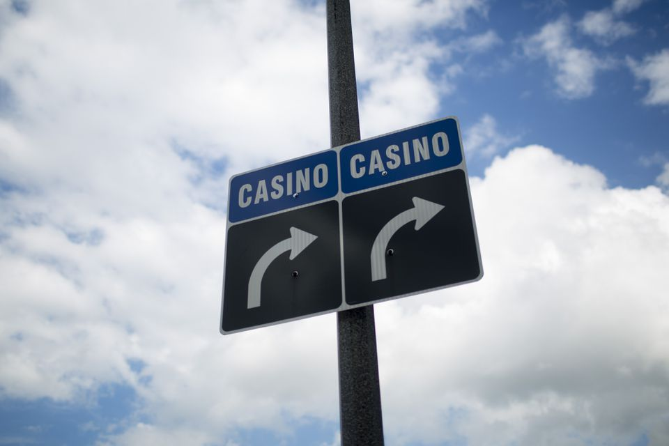 Signs directing to people to casinos are seen in Niagara Falls, Ontario, Canada