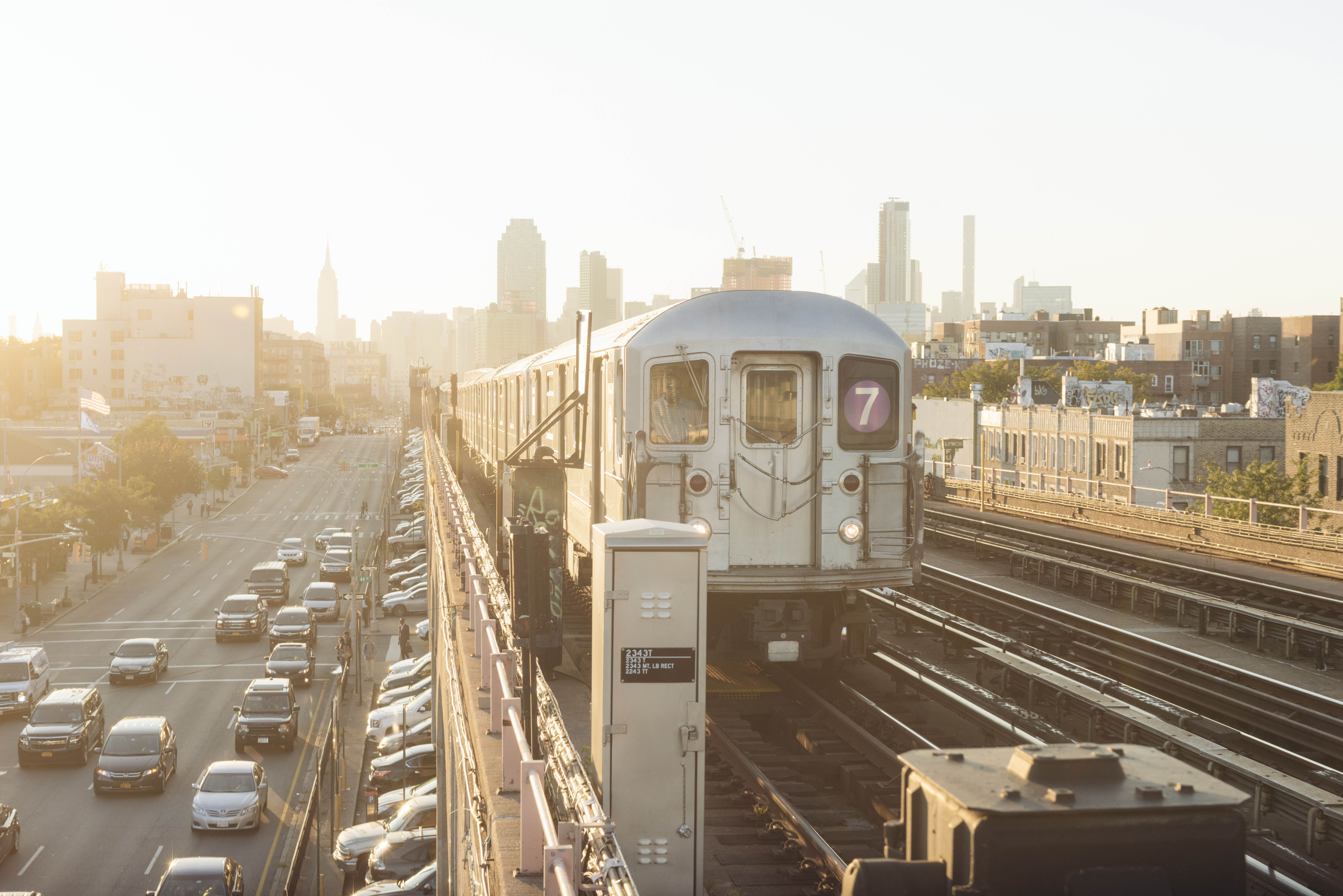 7 train going into Manhattan from Queens during sunset
