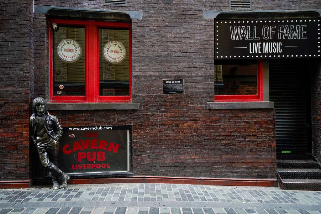 The statue of John Lennon stands in a deserted Mathew Street, the home of the famous Cavern Club,