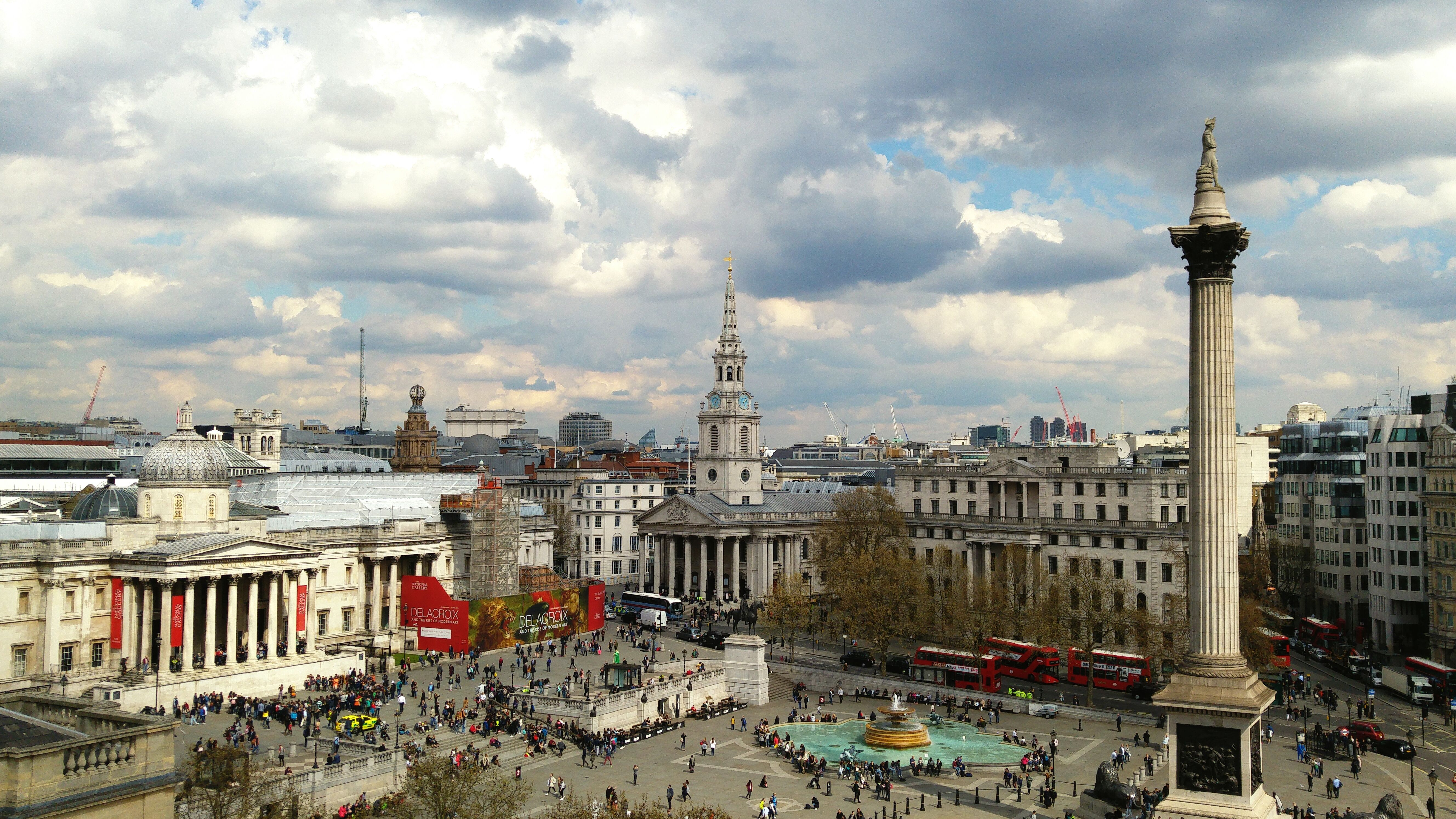Nelson Column at Trafalgar Square in the city against a cloudy sky