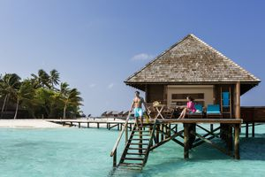 Young couple on terrace of water bungalow