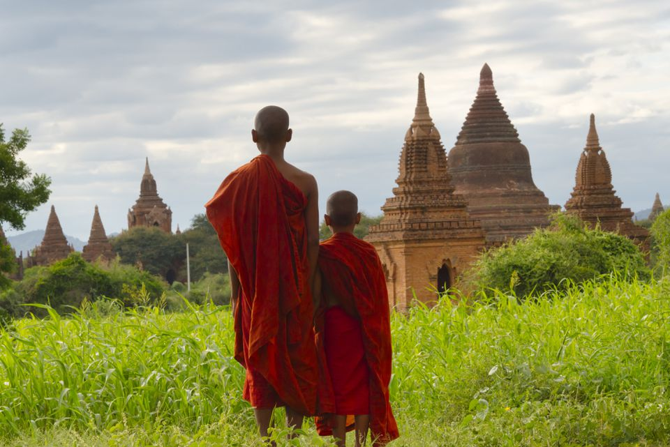 Buddhist Monks View Stupas at Bagan, Mandalay Region, Burma (Myanmar).