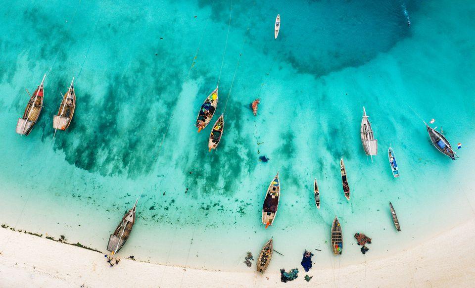 Aerial views of dhows on the beach in Zanzibar