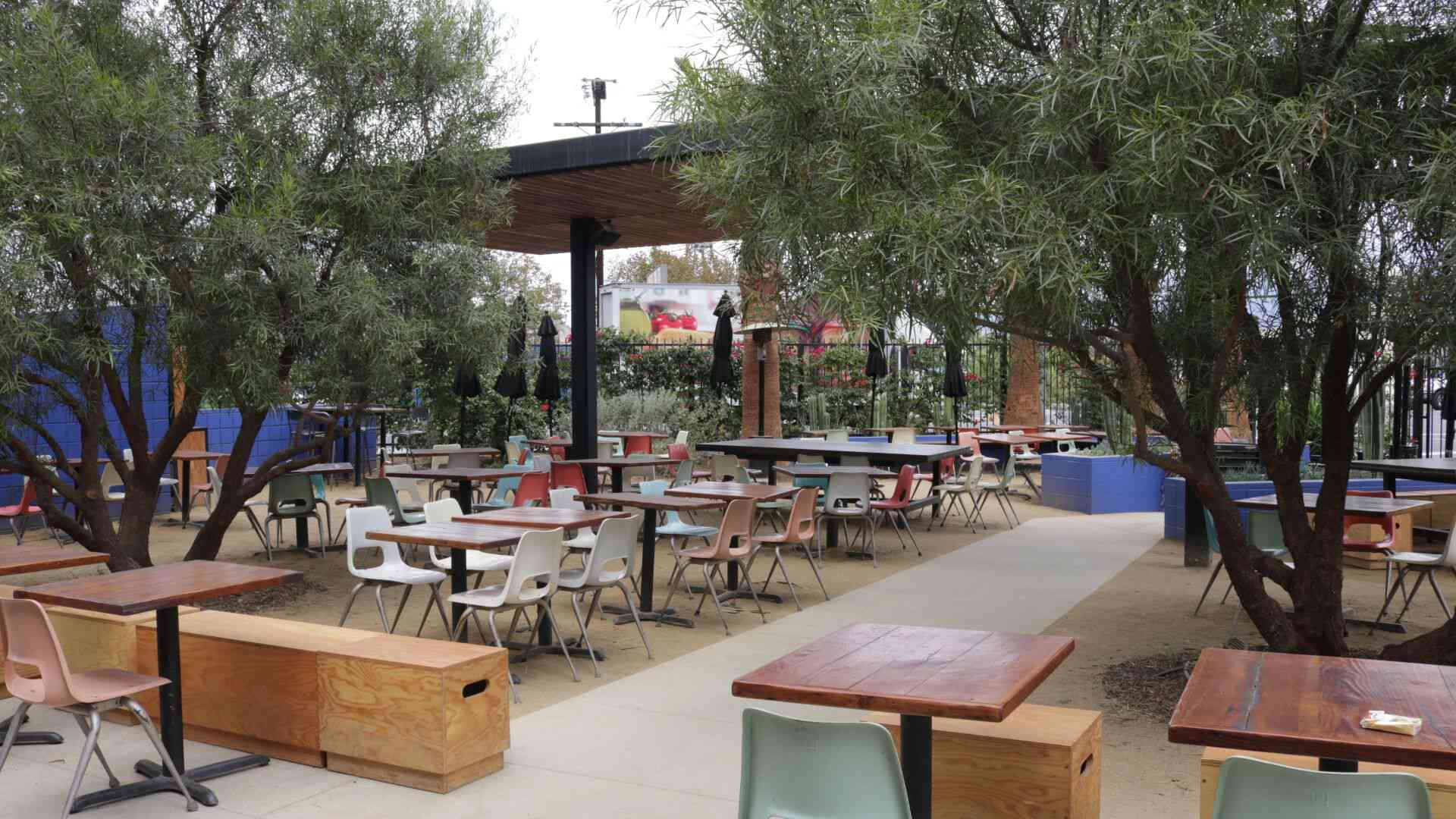 Outdoor tables and a plastic chairs at Salazar restaurant
