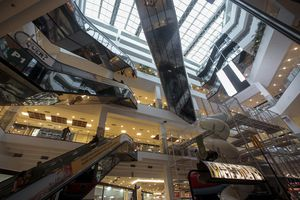 low-angle view of an indoor mall and many escalators