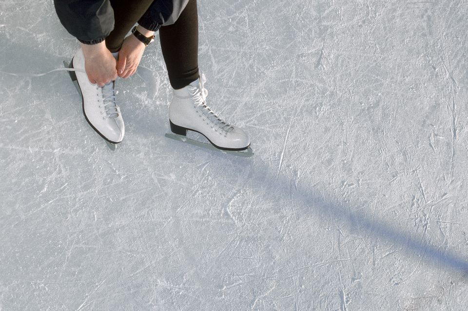 Woman Lacing Ice Skates