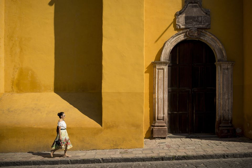 Woman walking along street, San Miguel de Allende, Guanajuato, Mexico, North America