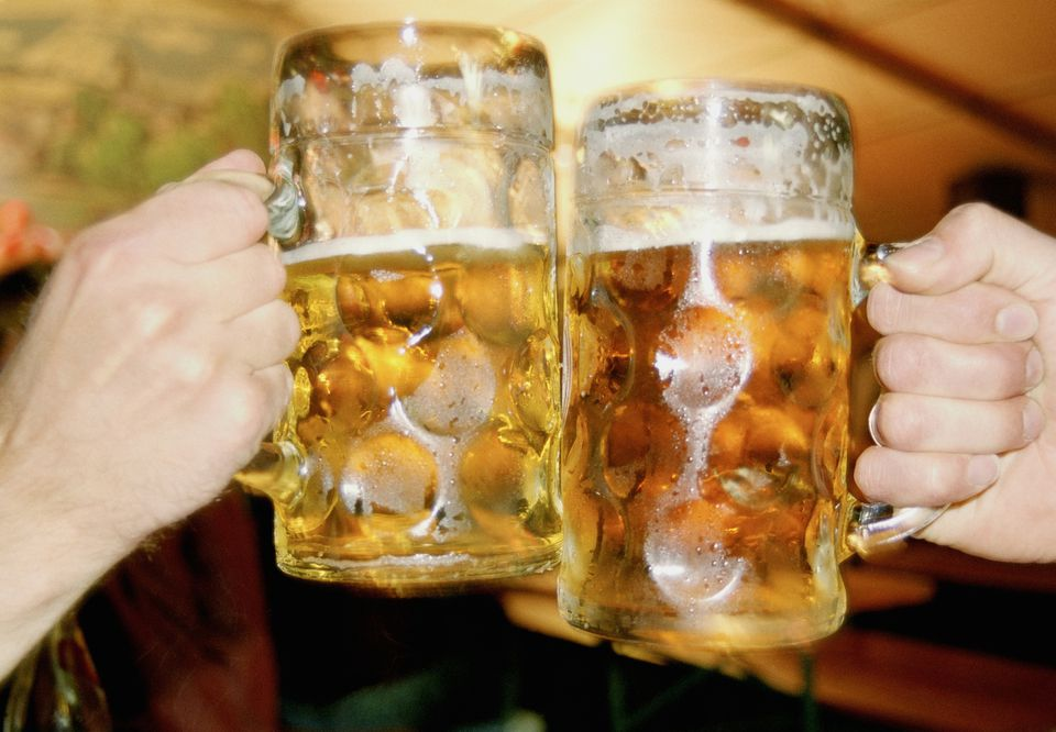 Toasting with beer steins