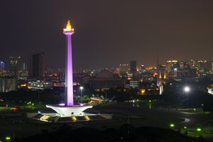 National Monument Monas with lights on in the night, Jakarta City, Indonesia