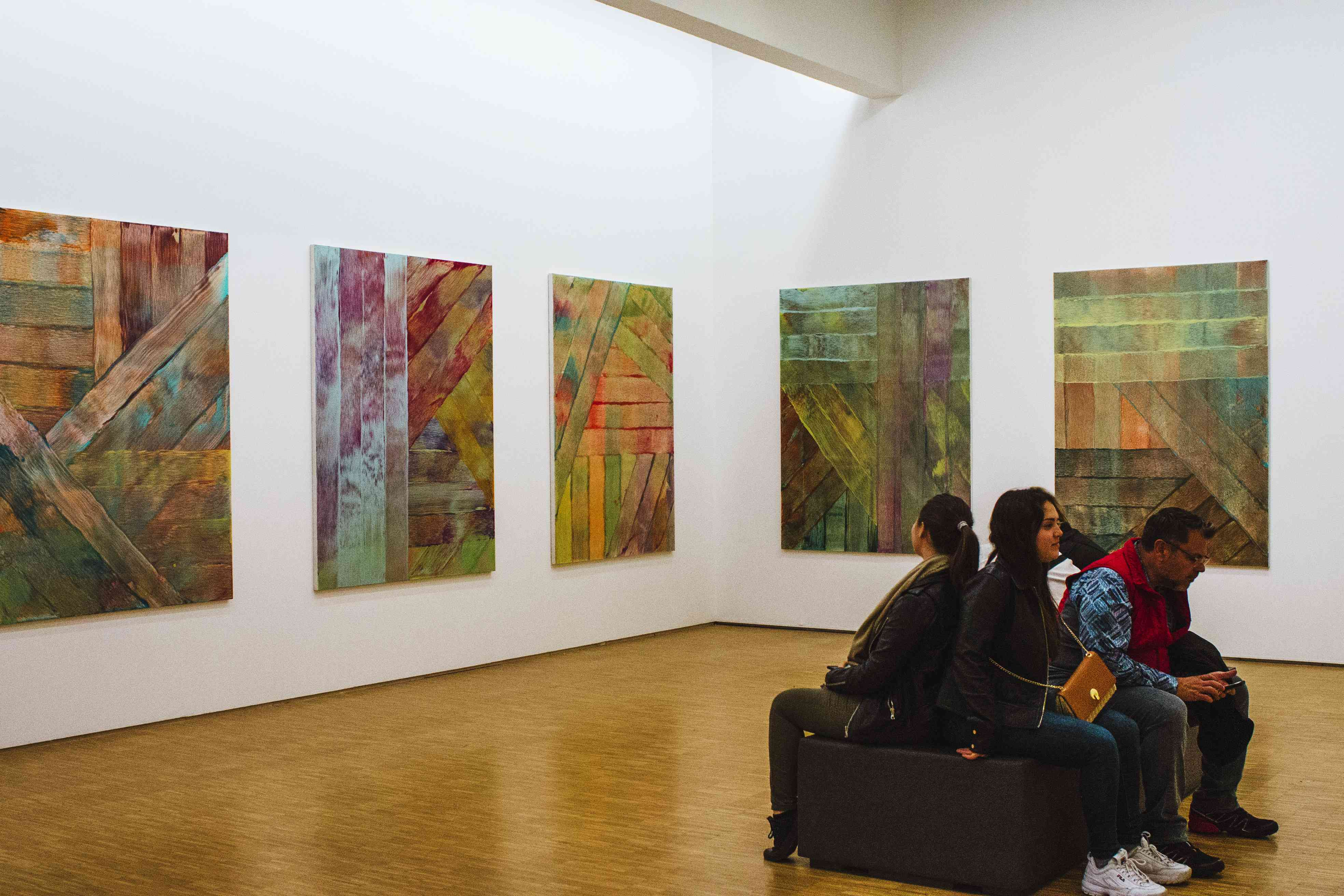 People in a room of abstract paintings in Centre Pompidou