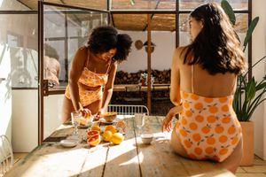 Women making breakfast in swimsuits