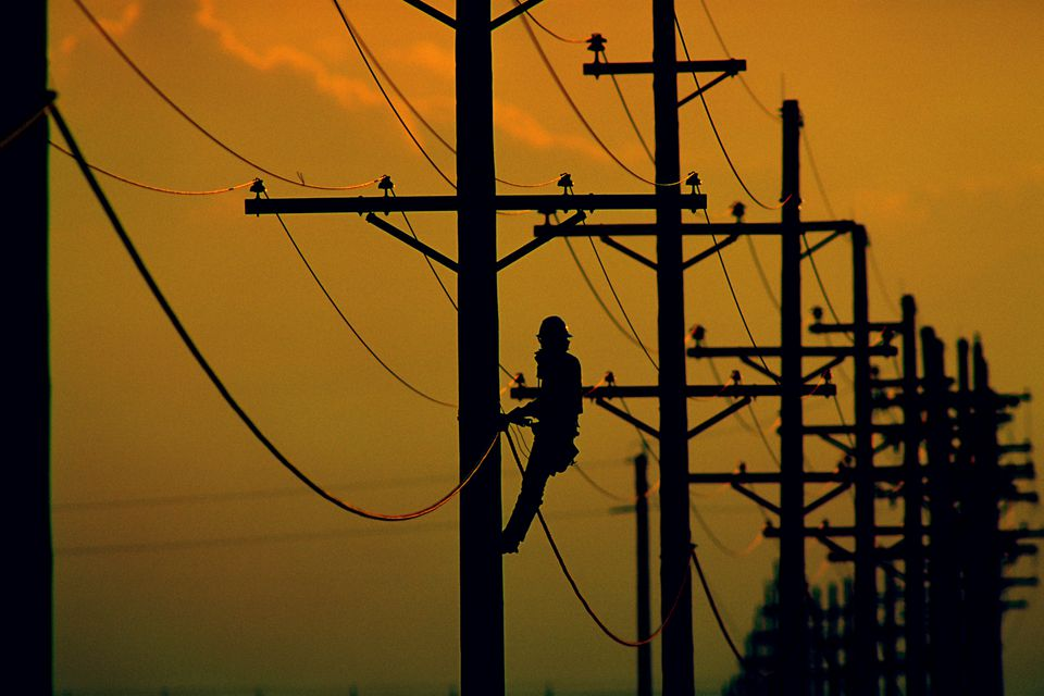 Lineman on power lines