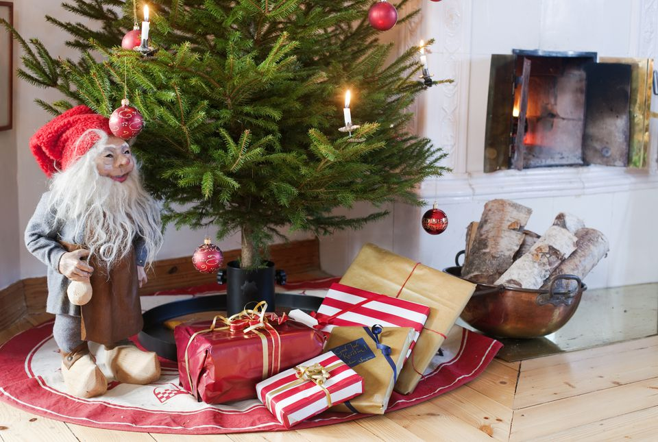Sweden, Gifts and Tomte figurine under Christmas tree