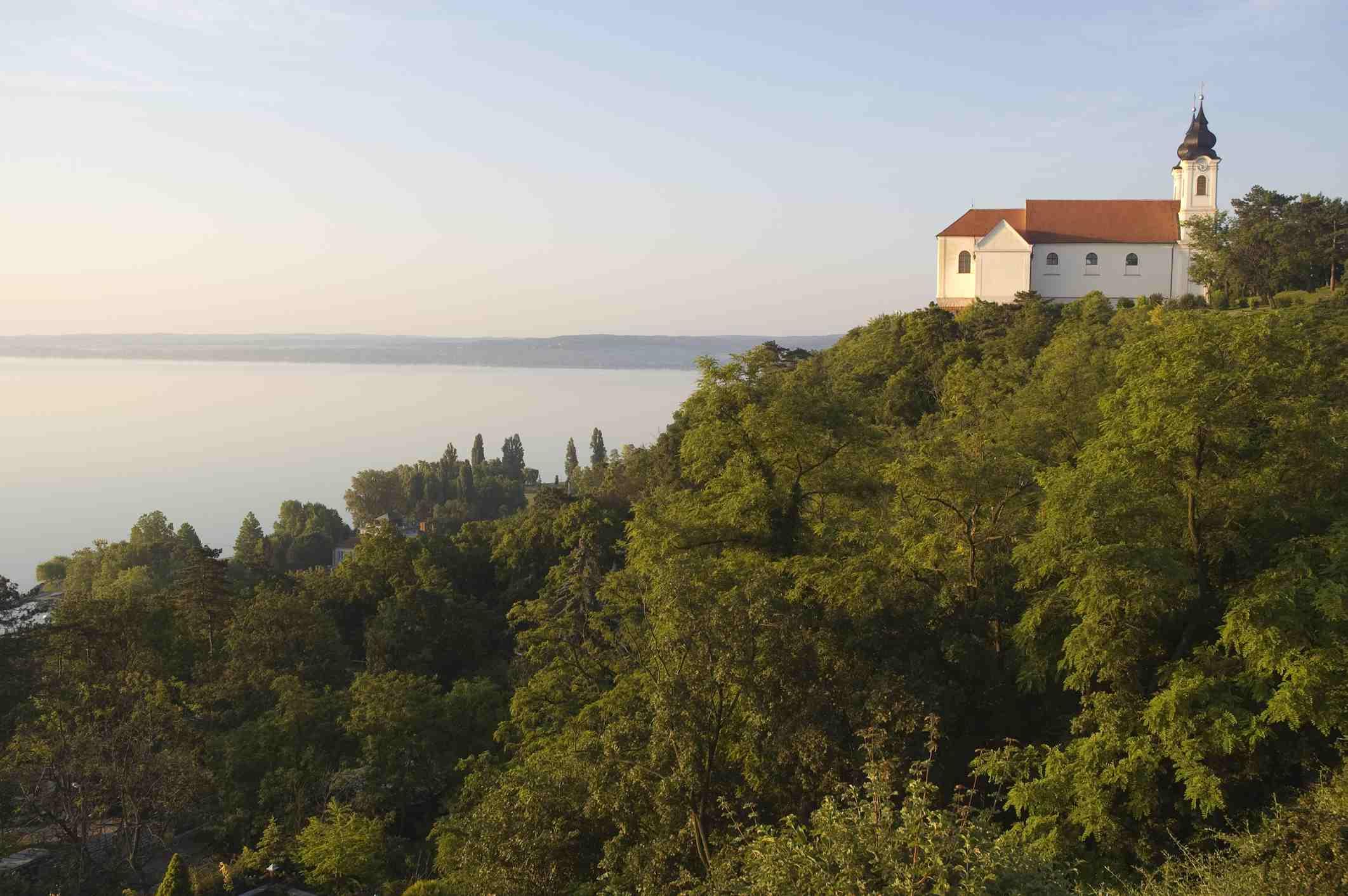 Abbey Church with twin onion-domed clocktowers overlooking Lake Balaton.