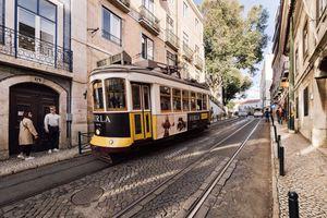 A tram going through Lisbob