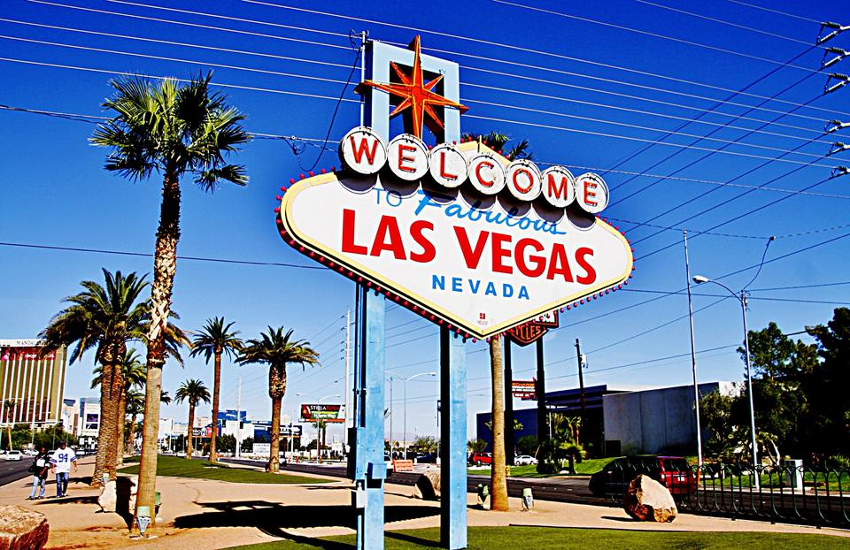 Low Angle View Of Welcome To Las Vegas Signboard Against Blue Sky
