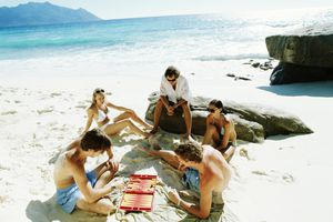 Adults playing game on the beach