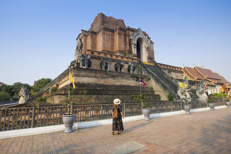 Tourist sightseeing at Wat Chedi Luang in Chiang Mai, Thailand
