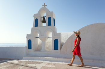 Woman In Red Walking Greek Town Santorini