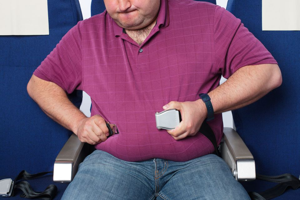 Overweight man in an airplane
