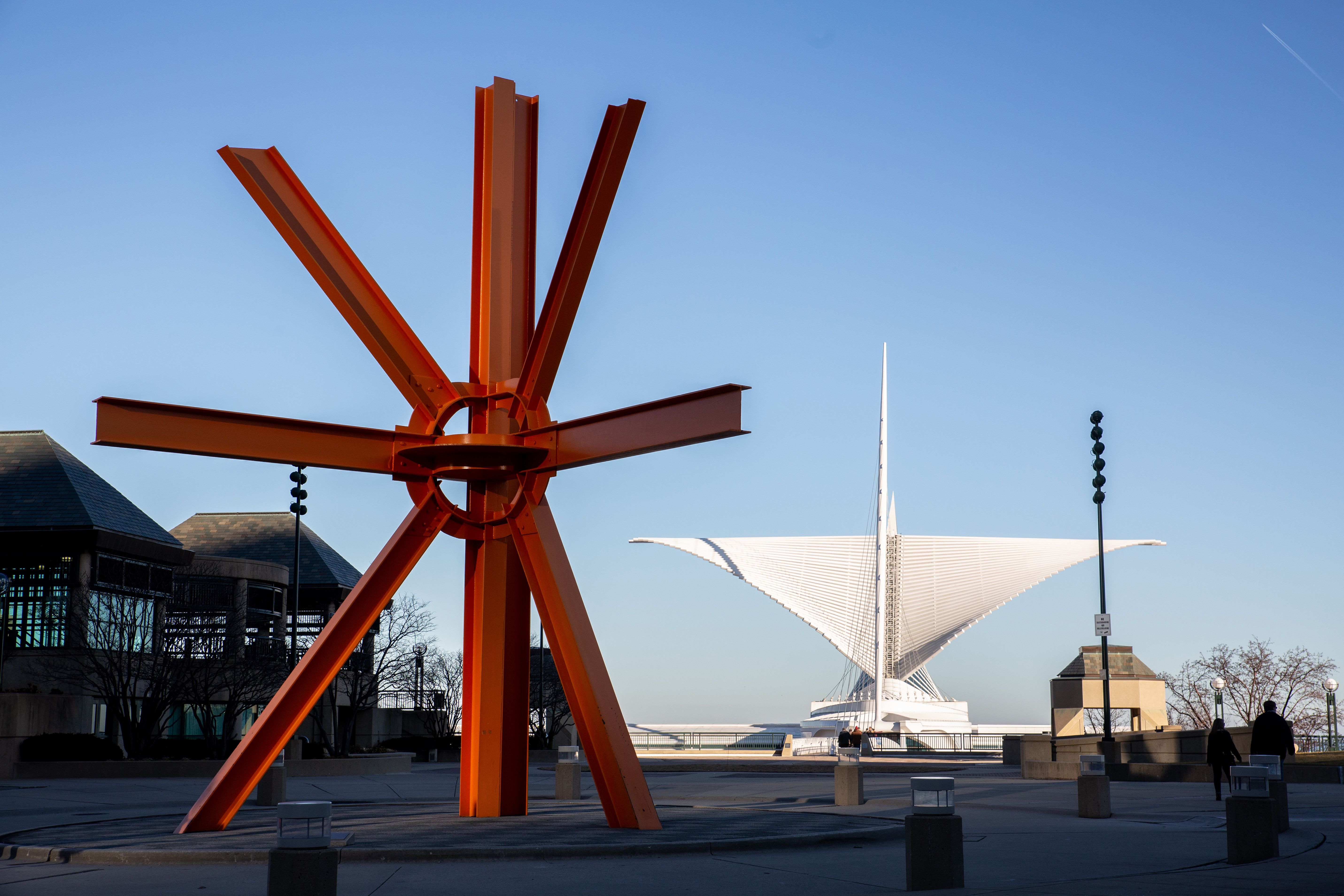 Exterior of the Milwaukee Museum of Art with a public sculpture out front.