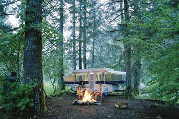 Couple camping in the middle of a forest
