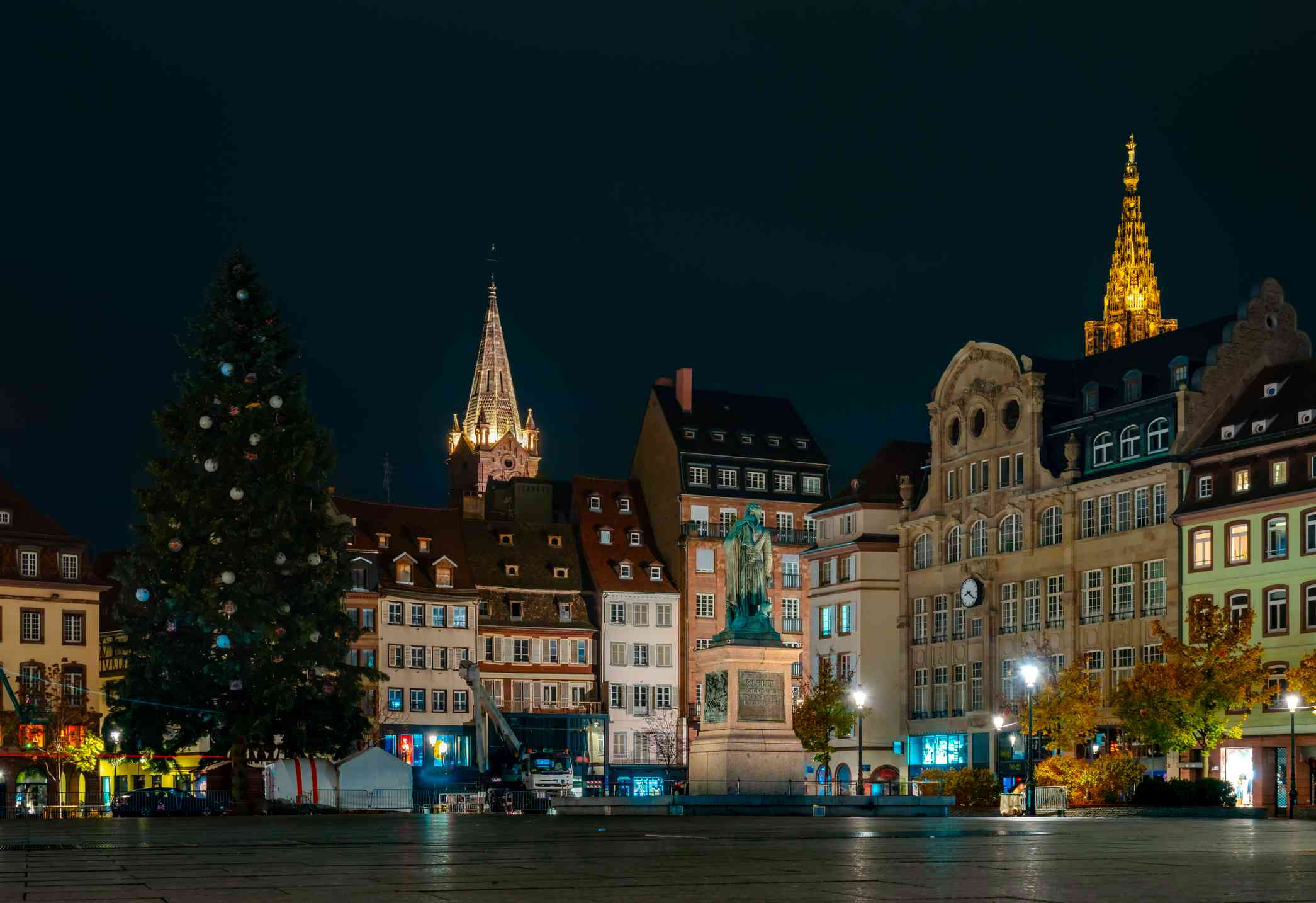 Central place Kleber in Strasbourg. Decorating of the huge christmas tree. Hi resolution night panoramic view. France.