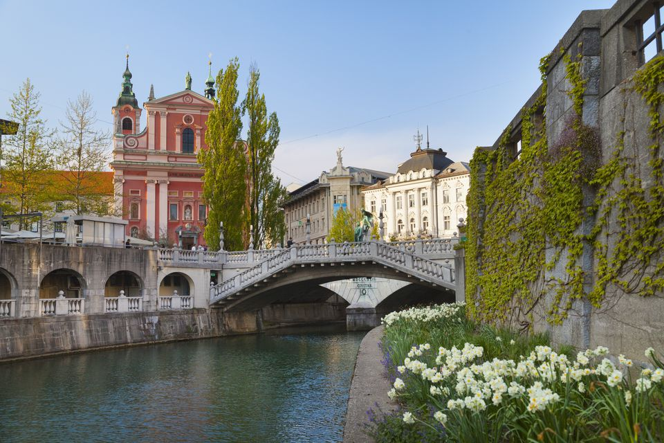 Ljubljana city center, Lublijanaka river, Tromostovje bridge and Franciscan Church of the Annunciation, Slovenia