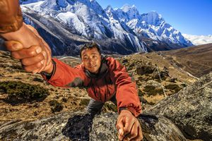 A guide in Nepal with mountain backdrop