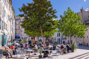 people sitting on chairs in a square in the