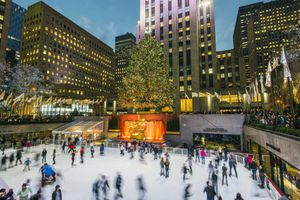 USA, New York, New York City, Manhattan, Lower Plaza of Rockefeller Center with ice skating rink and Christmas tree