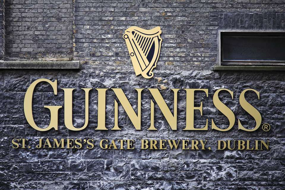 Ireland, Dublin, St James Gate, The Guinness logo and trademark on the wall of the St. James' Gate Brewery.
