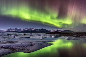 Aurora Borealis (northern lights) over the glacier lagoon, Jokulsarlon, on Iceland.